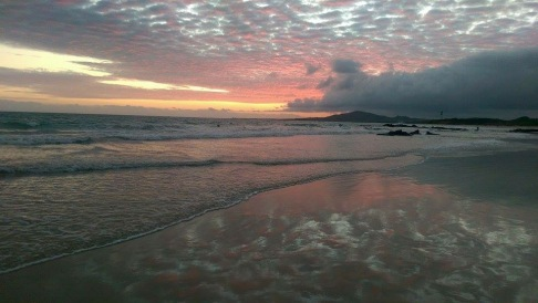 Beautiful sunset from the beach in Puerto Villamil.